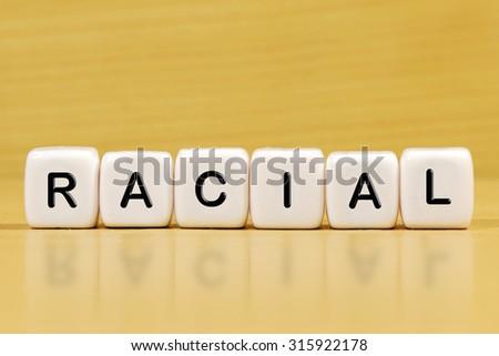 RACIAL word on blocks - stock photo