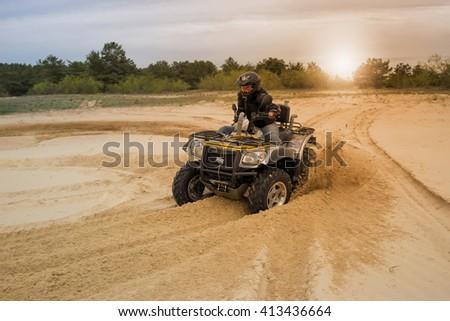 Racing ATV is sand.  - stock photo