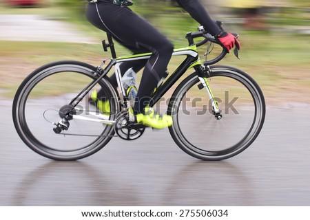 Racing Bike motion blur male cycling bicycle. - stock photo