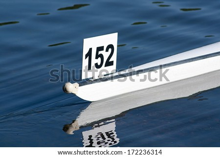 Racing boat shell competing in a competitive rowing race - stock photo