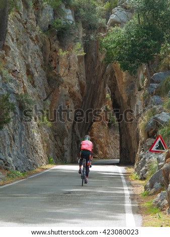 racing cyclist on the way through a tunnel