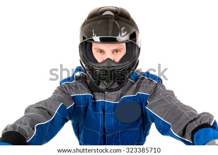 Racing driver posing with helmet isolated in white - stock photo