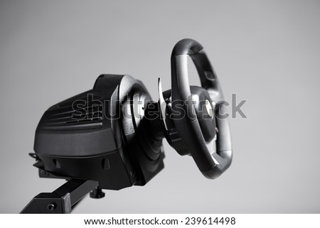 racing wheel for computer driving simulator, isolated on white - stock photo
