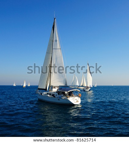 Racing yacht in the Mediterranean sea on blue sky background. - stock photo