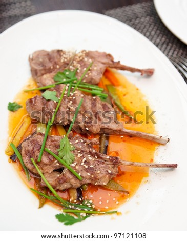Rack of lamb on restaurant table
