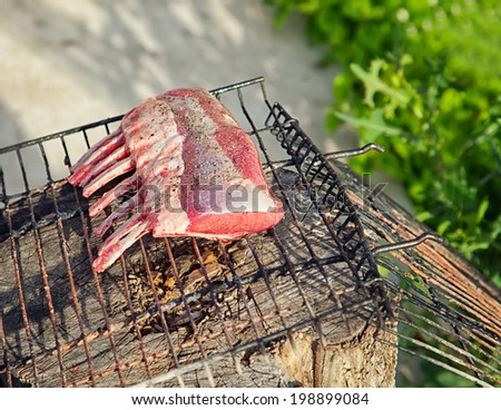 rack of lamb with spices on the grill - stock photo