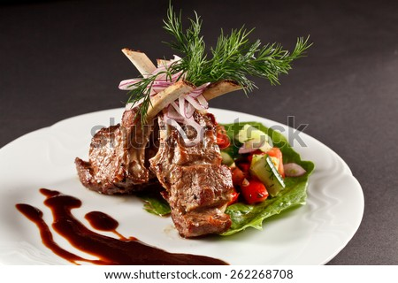 rack of lamb with vegetables and sauce - stock photo