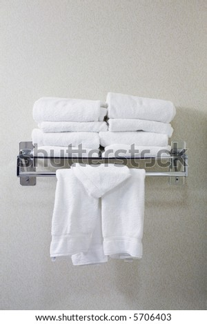 Rack of white towels - stock photo