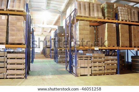 rack stack arrangement of cardboard boxes in a warehouse - stock photo