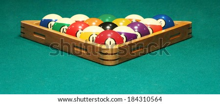Racked balls set for a game of 8 ball - stock photo