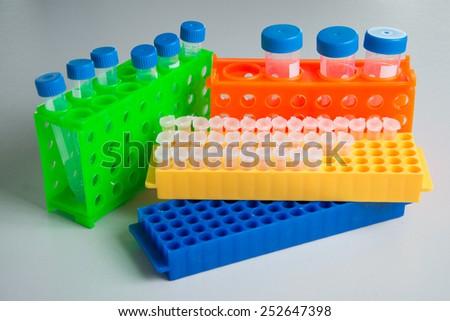 racks, centrifuge tubes, cell culture, falcon tubes, microchentrifuge racks - stock photo