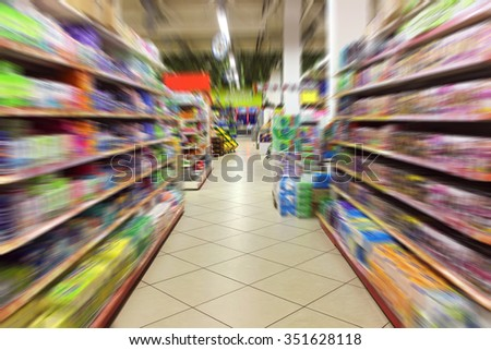 Racks in a supermarket with the range of cosmetics and means of hygiene. Pass in a supermarket.