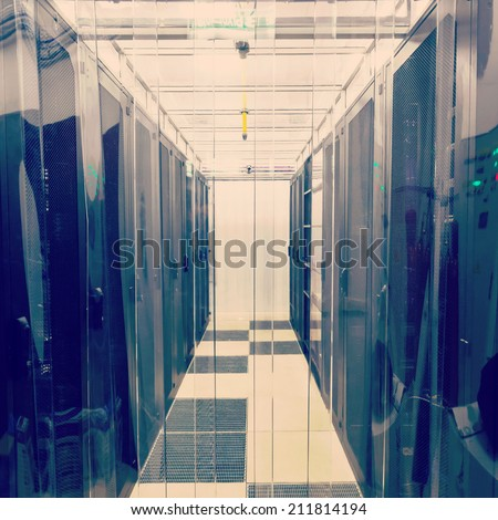 racks in the data center in the cold aisle through the transparent curtains - stock photo