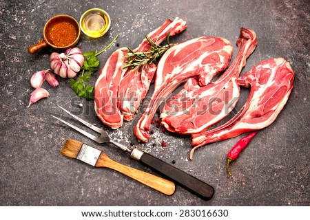 Racks of lamb ready for cooking on dark background - stock photo