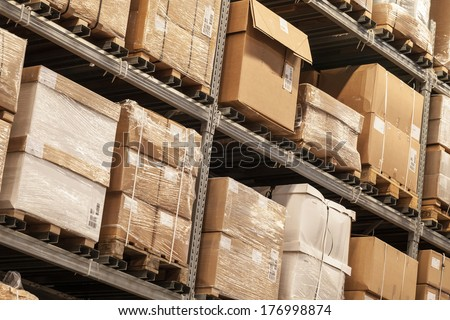Racks with boxes are in storage room - stock photo