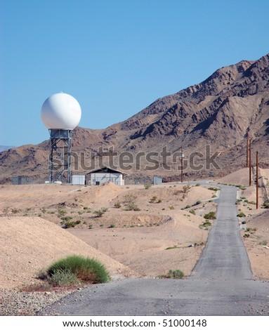 Radar dome in the desert - stock photo
