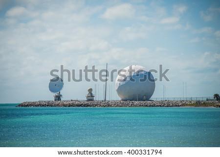 radar dome technology on the sea coast - stock photo