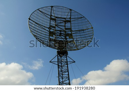 Radar station has circle form. Radar sttion on blue sky background.Front view. Russia.