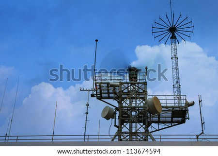Radar tower at industrial harbor in evening sky - stock photo