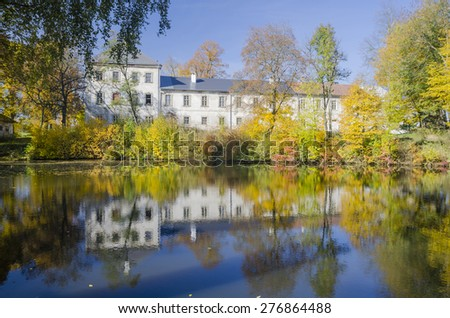 Radesin castle with lake and colorful autumn trees, Czech republic - stock photo