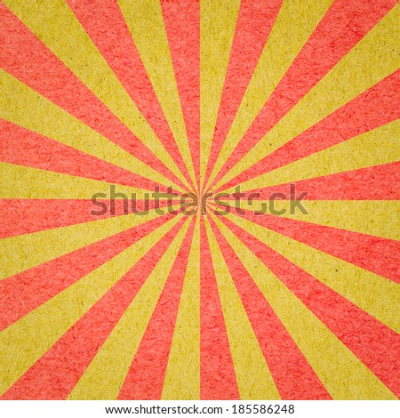 Radial background made of red and yellow recycled paper - stock photo