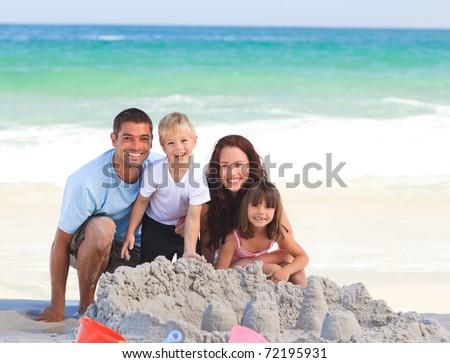 Radiant family at the beach - stock photo