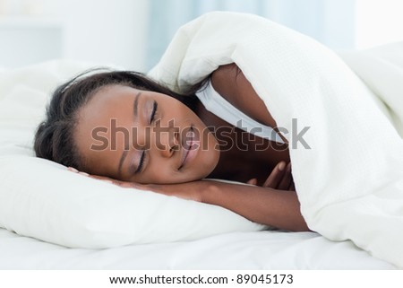 Radiant woman sleeping in her bedroom - stock photo