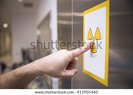 Radiation sign on door of operating room in a hospital - stock photo