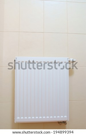 Radiator adjustment closeup. adjusting radiator temperature.  - stock photo