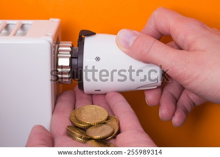 Radiator adjustment to save energy. Save energy and money concept - stock photo