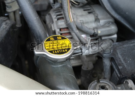 Radiator cap with warning label in a car