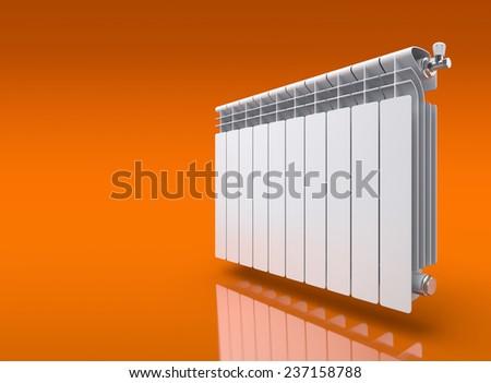 Radiator on orange reflective background - stock photo