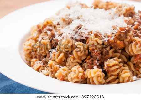 radiatore pasta with parmesan and meat stuffed tomato sauce
