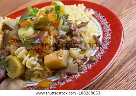 Radiatori - Pasta  with beef, mushrooms, eggplant .italian cuisine
