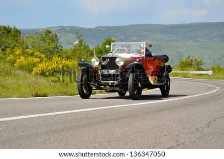 RADICOFANI (SI) ITALY - MAY 19: A red OM 665 Superba built in 1925, takes part to the 1000 Miglia 2012, on May 19, 2012 in Radicofani (SI) - stock photo