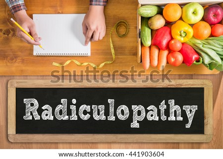 Radiculopathy fresh vegetables and  on a wooden table - stock photo