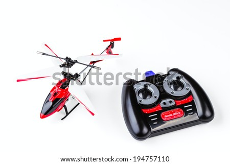 radio-controlled model of the helicopter with the control panel isolated on a white background - stock photo