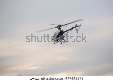 Radio controller Helicopter flying in the sky fly moment moving blade