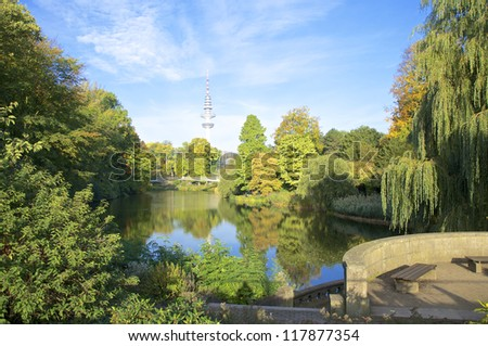 Radio telecommunication tower and the city park Planten un Blomen in the heart of Hamburg. The Tower is named after the German physicist and Hamburg-born Heinrich Hertz - stock photo