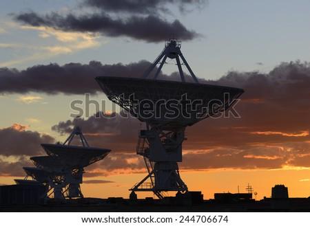 Radio Telescopes at Sunset in New Mexico - stock photo