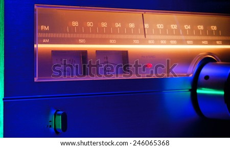 Radio tuner vintage stereo, analog dial AM/FM close up. Color filters. - stock photo