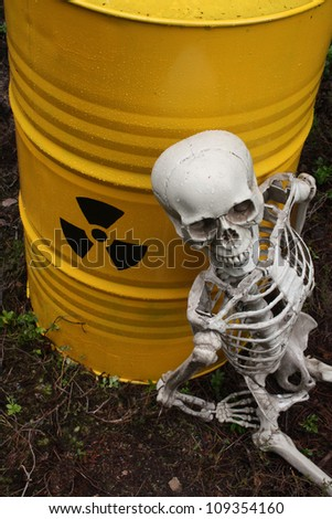Radioactive waste and skeleton - stock photo