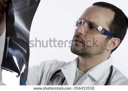 Radiologist looking at an x-ray in hospital - stock photo