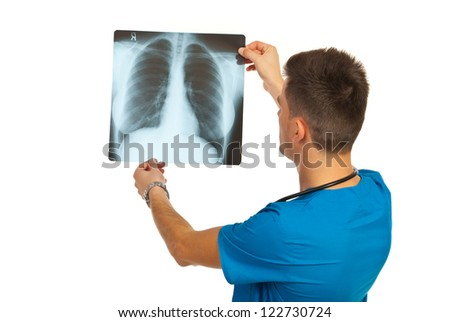 Radiologist man checking xray isolated on white background - stock photo
