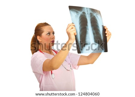 Radiologist woman looking on a X-ray isolated on white background - stock photo