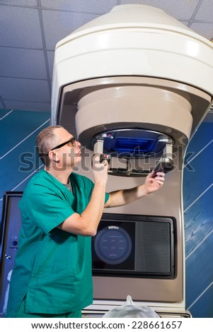 Radiotherapy room - Radiation therapy machine - Male radiologist