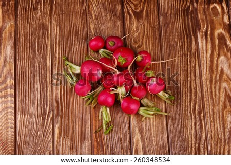 Radish on wooden background top view  - stock photo