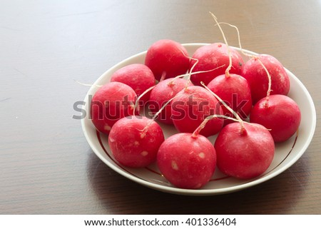 radishes on a plate - stock photo