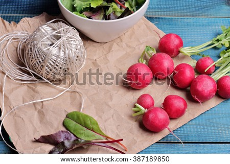 Radishes on blue rustic table. Fresh raw food diet salad.  Vegetarian food concept, healthy life style - stock photo