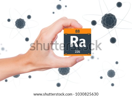Radium element symbol handheld and atoms floating in background